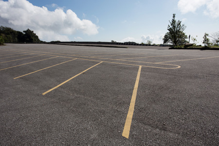 speedway park: asphalt roadway parking lot with cloud blue sky background