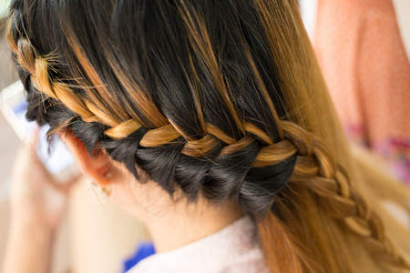 style: long braid creative brown hair style in salon beauty