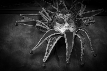 theatre masks: red carnival mask, black and white image
