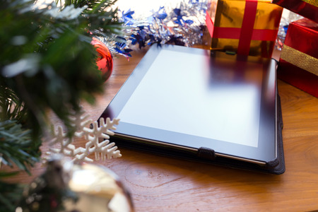 new technology: black tablet on table wood with christmas decoration