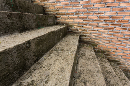 cement staircase in construction site with brick wall photo