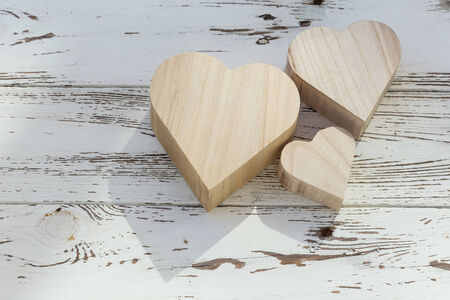 heart wooden box on white wood background photo
