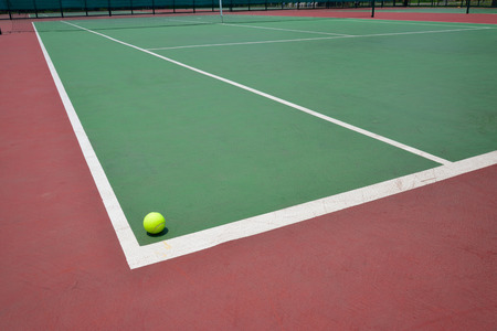 tennis ball on green court, sport background photo