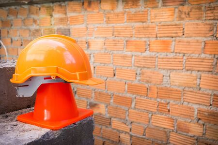 construction helmet safety and cone in construction site with bricks photo