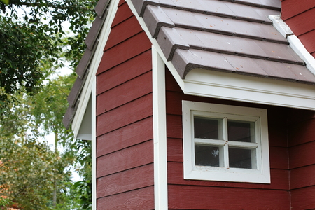 garret: attic with white wood window on the roof house Stock Photo
