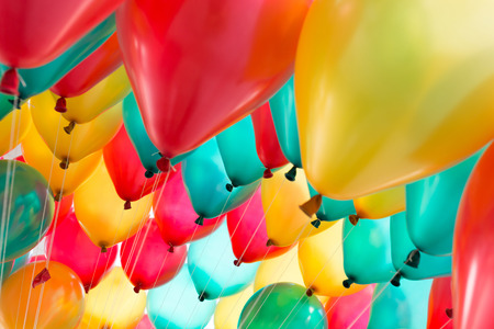 colorful balloons with happy celebration party background Stock Photo