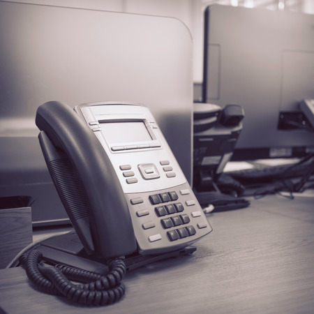 black telephone on table work of office photo