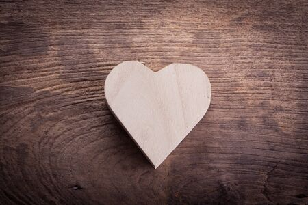 heart brown wood box on wood background, abstract love background photo