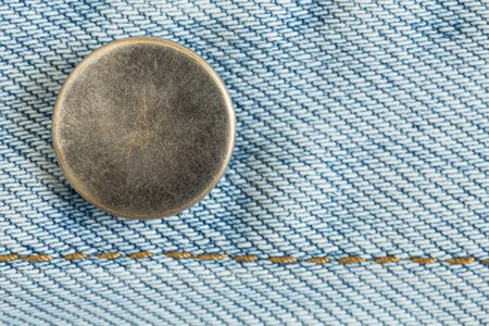 worn jeans: old metal button of jeans fashion