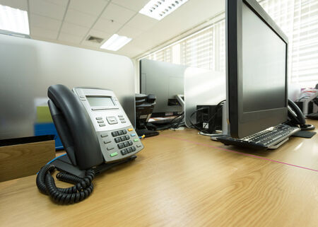 table work in office with telephone and computer pc