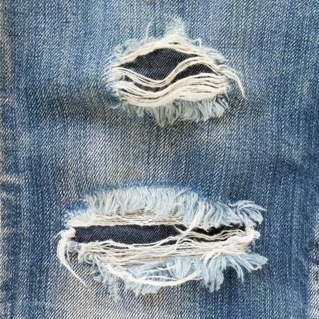 jeans texture: denim jeans blue old torn of fashion design Stock Photo
