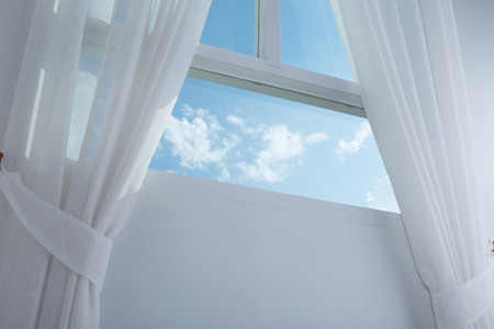 white curtain on the window with blue sky photo