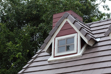 attic: attic with white wood window on the roof house Stock Photo