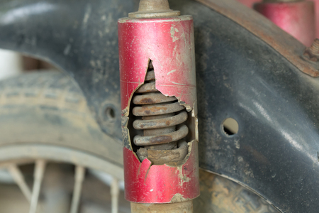 chock: motorcycle chock absorber rusty crack broken Stock Photo