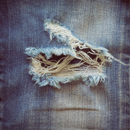 worn jeans: denim jeans with old torn of fashion jeans design Stock Photo