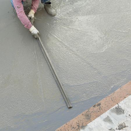 plasterer: plasterer concrete cement worker plastering flooring of house construction Stock Photo