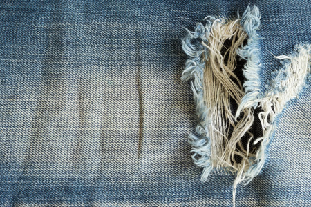 jeans texture: denim jeans with old torn of fashion jeans design Stock Photo