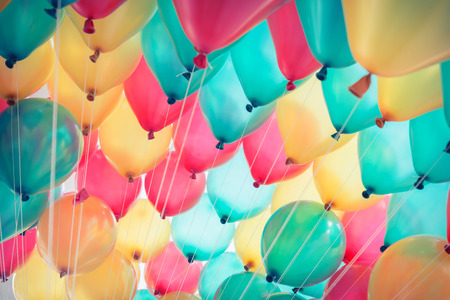 holiday backgrounds: colorful balloons with happy celebration party background Stock Photo