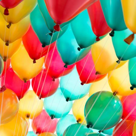 holiday celebration: colorful balloons with happy celebration party background Stock Photo
