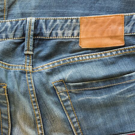 cotton  jeans: blue jeans with back pocket and brown leather tag Stock Photo
