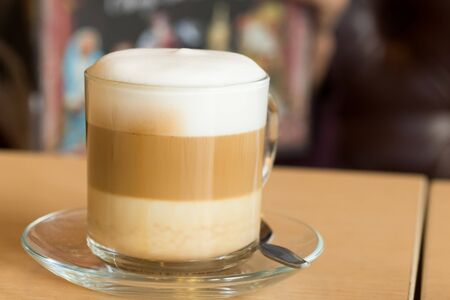 froth: coffee latte with milk froth in cafe