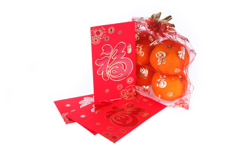 envelope decoration: red envelope and orange fruit of chinese new year decoration on white background