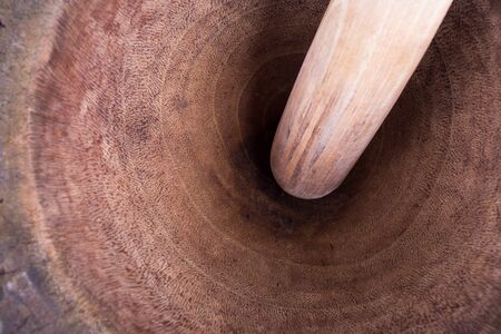 pestle: wooden mortar and pestle