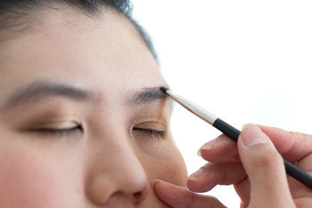 pretty woman face: eye makeup with brush on pretty woman face
