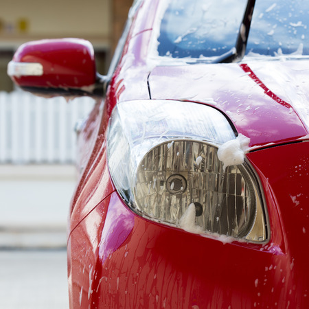 car wash with soap, car cleaning service Stock Photo