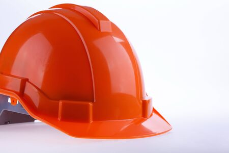 industry background: orange safety helmet hard hat, tool protect worker of danger in construction industry, isolated on white background Stock Photo