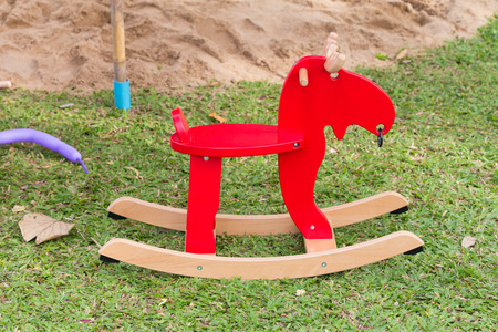 playground ride: rocking deer chair for kids ride playing in playground Stock Photo