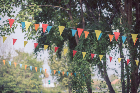 colorful triangular flags of decorated celebrate outdoor party Archivio Fotografico