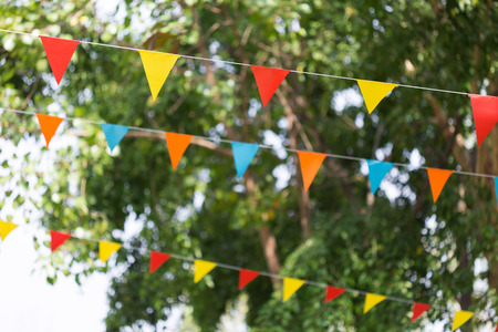 colorful triangular flags of decorated celebrate outdoor party Zdjęcie Seryjne