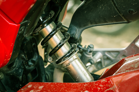 shock absorber: metallic shock absorber of motorcycle Stock Photo
