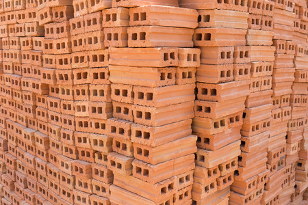 residential construction: pile of brick block used for industrial in residential building construction site, image for industry background