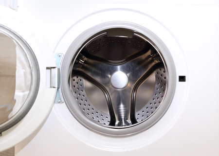 housework: white washing machine for housework clothes cleaning