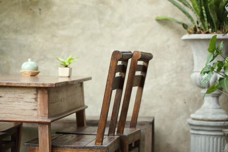 vase plaster: set of wooden table and chair decorated in garden, interior of cafe coffee shop with natural