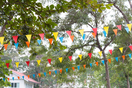 colorful triangular flags of decorated celebrate outdoor party Stock Photo