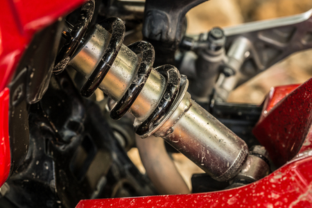 springy: metallic shock absorber of motorcycle Stock Photo