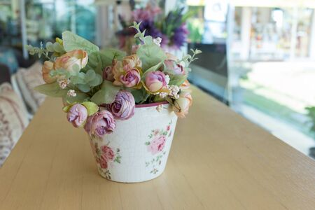 decoupage: flowers vase decoupage decorated on wooden table at living room, artificial flowers in vase