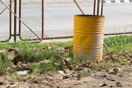 trashcan: yellow trashcan of recycle old fuel tank