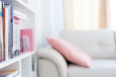 furniture home: blur image background, book shelf and sofa furniture interior decoration in home Stock Photo