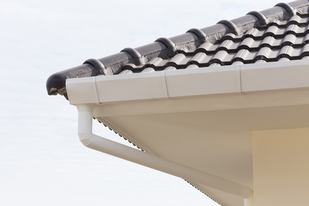 gutter: white gutter on the roof top of house