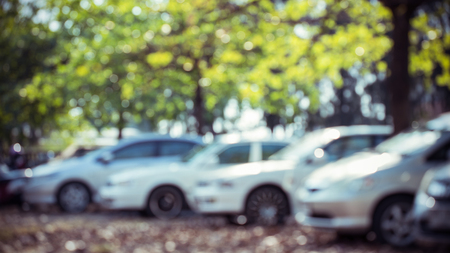car parking lot with tree green nature, abstract blur background Stock Photo