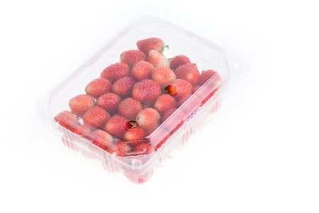 packaging: red ripe strawberry in plastic box of packaging for sale, isolated on white background Stock Photo