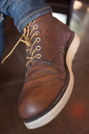 shoestring: old brown boot leather shoes, close-up image