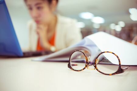 working woman: close-up eyeglasses, study education, working woman