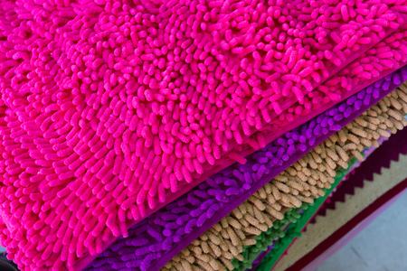 softness: colorful carpet softness texture of doormat, close-up image Stock Photo