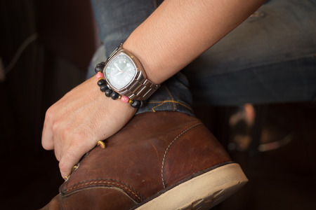 attractiveness: brown boot leather shoes and jean pants clothing fashion of man