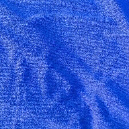 softness: blue towel softness fabric texture, closeup image Stock Photo